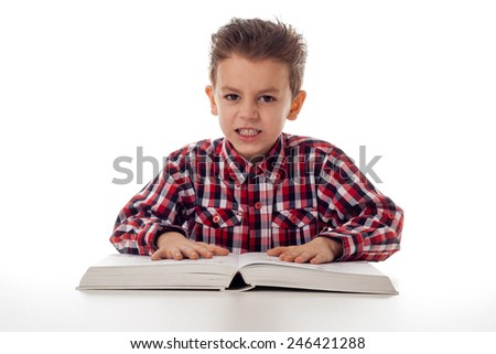 young angry boy in shirt and a big book - stock photo