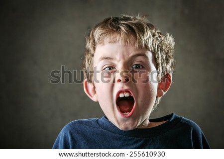 Young Angry boy yelling - stock photo