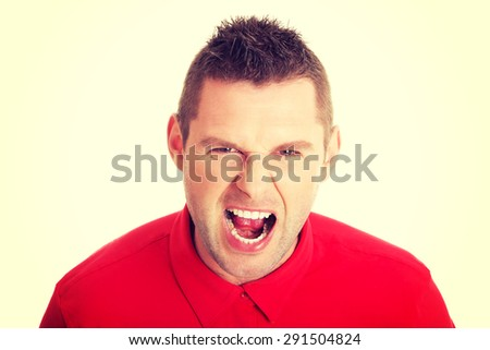 Young angry man screaming on you - stock photo