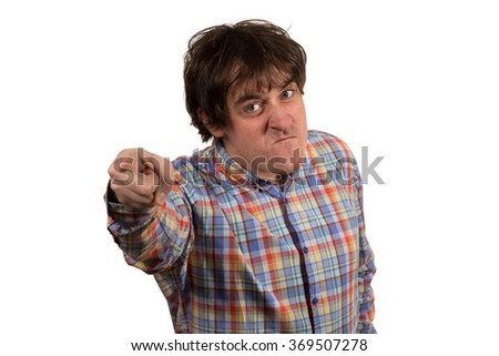Young angry student pointing at you. Isolated on white background. - stock photo