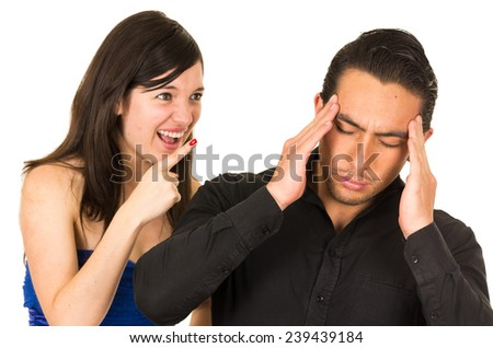 young angry woman screaming at boyfriend husband isolated on white - stock photo