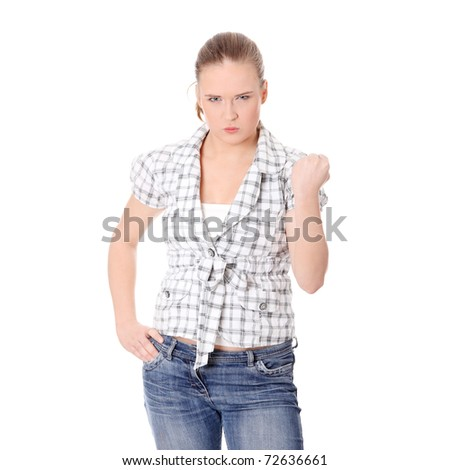 Young angry woman with fist up, isolated - stock photo