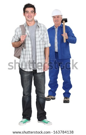 Young apprentice standing near his boss - stock photo