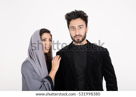 Young Arab couple on white background