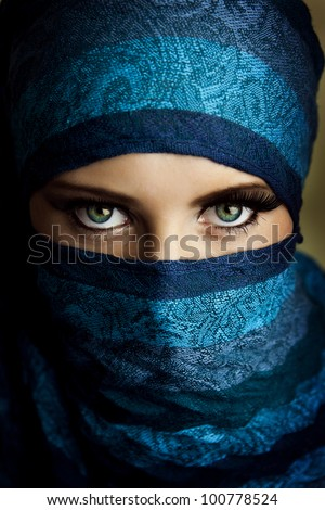 Young arabian woman in hijab with sexy blue eyes - stock photo