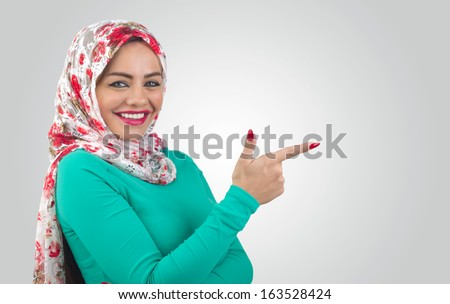 Young Arabian woman pointing her finger  - stock photo