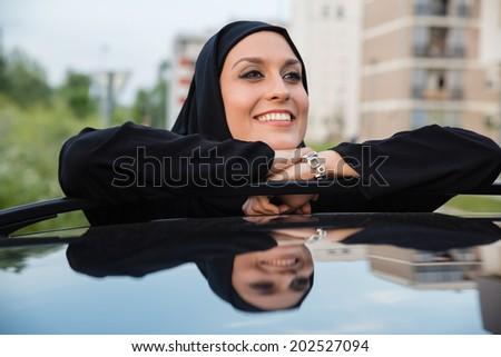 Young Arabian Woman Standing Next To Car - stock photo