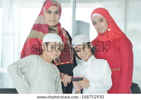 Young Arabic passengers traveling at the airport - stock photo