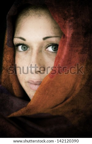 Young Arabic woman in wearing islamic scarf - stock photo