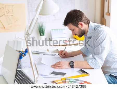 Young architect at his studio - stock photo