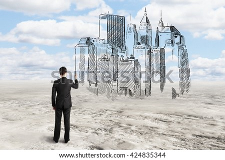 Young architect drawing abstract construction sketch on sky background - stock photo