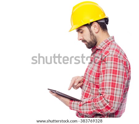 Young architect holding a tablet computer, isolated on white background - stock photo
