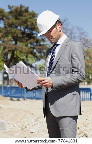 young architect on building site in summer - stock photo