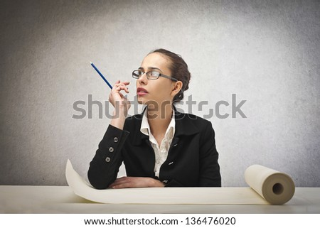 young architect thinks about the project - stock photo