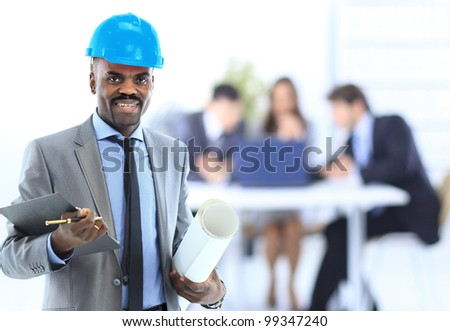 Young architect with drawings - stock photo
