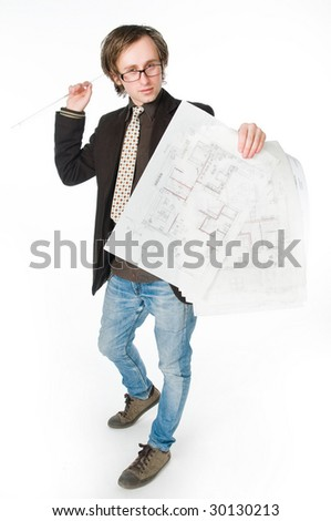 Young architect with sketch, studio shot - stock photo