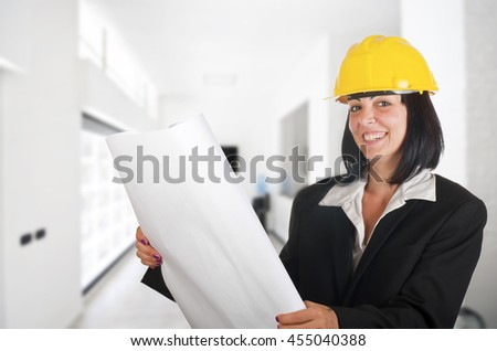 young architect woman with floor plan of a building  - stock photo
