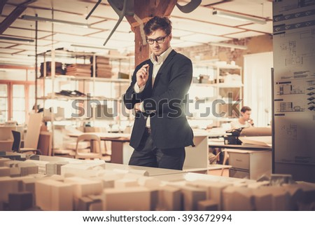 Young architect working in architect studio. - stock photo