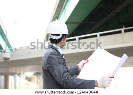 Young architect working on location on a construction site