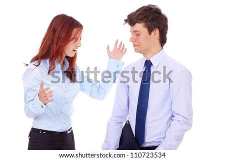 Young arguing angry businesswoman and businessman in blue shirts, isolated on white - stock photo