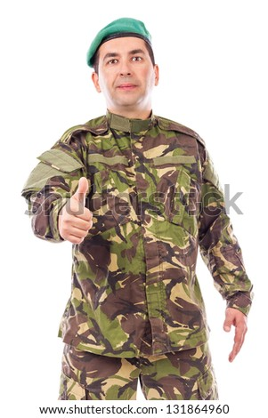 Young army soldier with thumb up isolated on white background