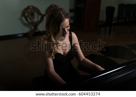 Young Artist in Black Velvet Evening Dress Playing at the Old Wooden Piano Classical Sonata by Gentle Candlelight