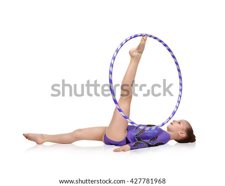 Young artistic athlete performs in blue clothes with hula hoop - stock photo