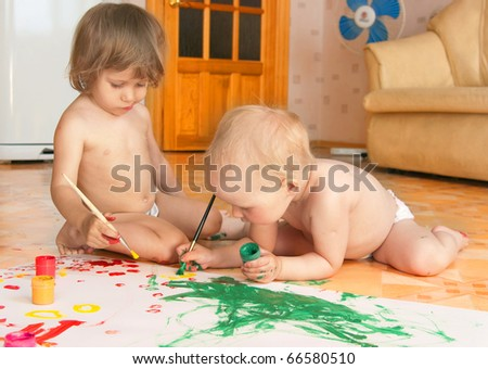 Young artists little girls draw lying on a floor - stock photo