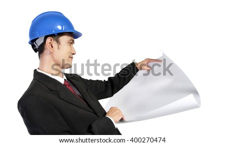 Young Asian architect looking at a paper scroll, isolated on white background - stock photo