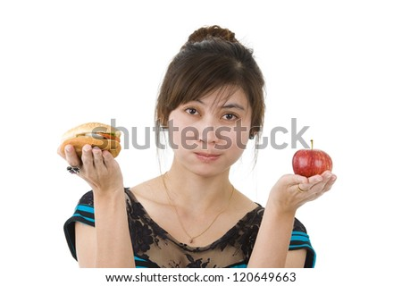 young asian beauty with hamburger and apple, isolated on white background
