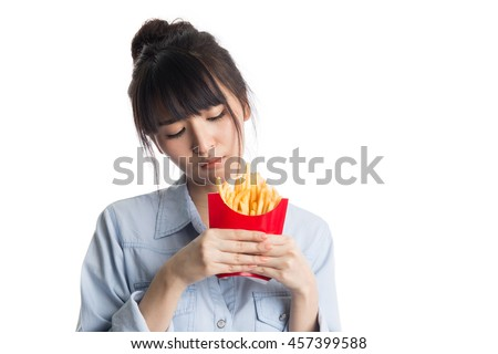 Young asian boring french fries, diet concepts, isolated on white background - stock photo
