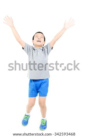 Young asian boy act like winning after race on white background