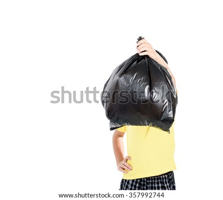 Young asian boy carry garbage in plastic bag for eliminate on the white background - stock photo