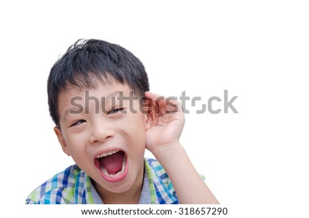 Young Asian boy cupping hand behind ear on white background - stock photo