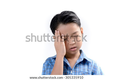 Young asian boy feel headache from fever at hospital. Heath concept - stock photo