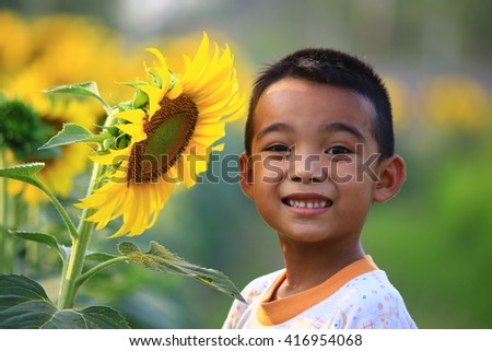 Young asian boy  in sunflower field