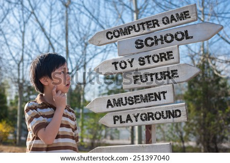 Young Asian boy making choices - stock photo