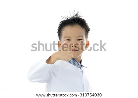 Young Asian boy portrait action thumb up isolated on white.