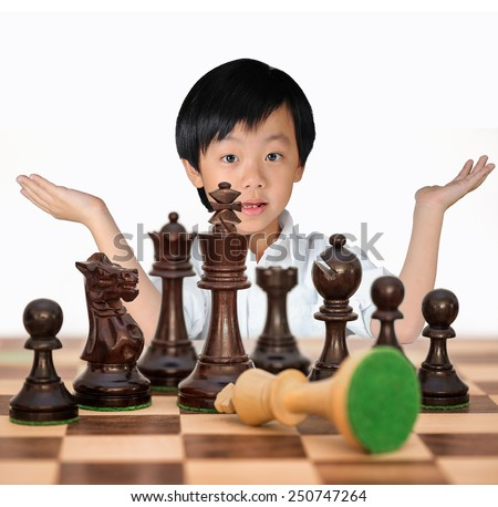 Young Asian boy winning chess game - stock photo