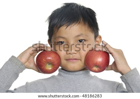 young asian boy with apple - stock photo