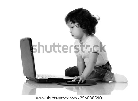 young asian boy with laptop on isolated white background - stock photo