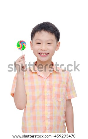 Young asian boy with lollipop over white background - stock photo