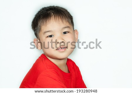 Young Asian boy with soft smile - stock photo