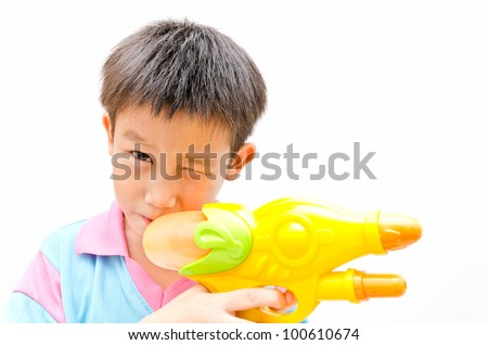 Young Asian boy with water gun - stock photo