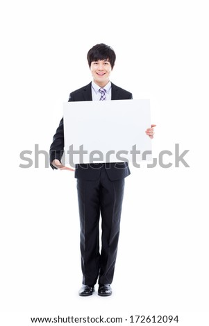 Young Asian business man holding a pannel isolated on white background.  - stock photo
