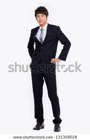Young Asian business man isolated on white background.