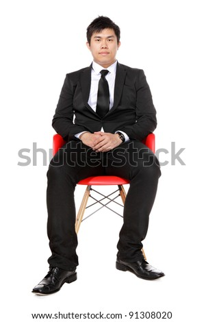 young asian business man sitting - stock photo