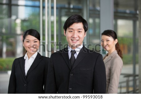 Young Asian business man with his successful business team in the office.