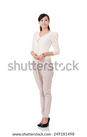 Young Asian business woman, full length portrait with reflection on studio white background. - stock photo