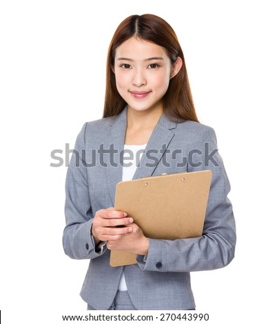 Young asian business woman holding file document - stock photo